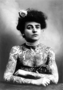 A 1907 photo of a woman with tattoos.